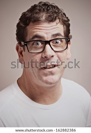 Funny weird expression goofy nerd man portrait  - stock photo