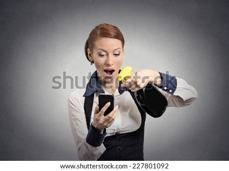 Funny woman holding smartphone and cleaning spray bottle for glass making it perfect, spotless isolated on grey wall background. Perfectionist obsessive compulsive personality  - stock photo