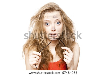 funny  woman holds bare wires - stock photo