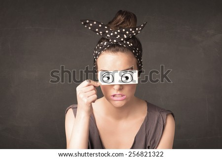 Funny woman looking with hand drawn paper eyes concept - stock photo