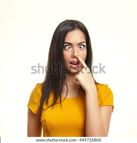 Funny Woman's Face Squinting Her Eyes. Cute Teen Picking Her Nose. - stock photo