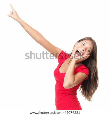 Funny woman surprised screaming and pointing at copy space. Beautiful mixed race caucasian / chinese young woman model. Isolated on white background. - stock photo