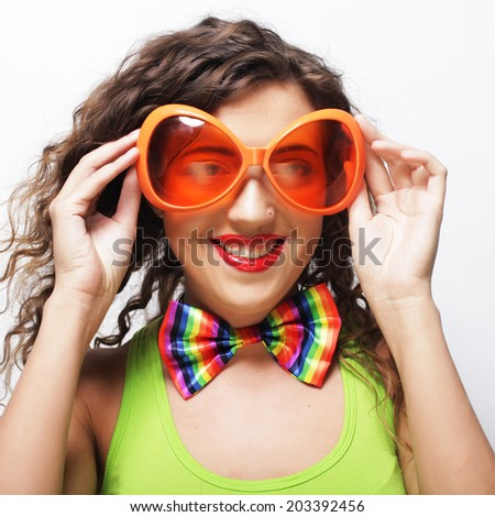funny woman wearing big bright sunglasses