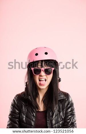 funny woman wearing cycling helmet portrait pink background real people high definition - stock photo