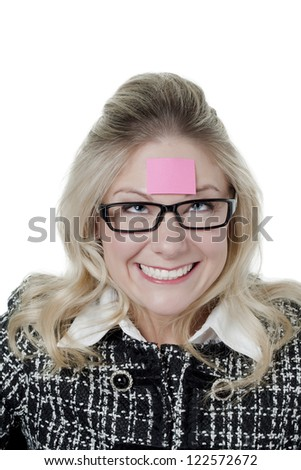 Funny woman with pink sticky note on forehead - stock photo