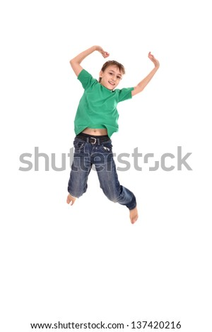 funny young boy jumping on a white background