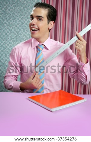 Funny young businessman with measuring ruler, size matter metaphor - stock photo