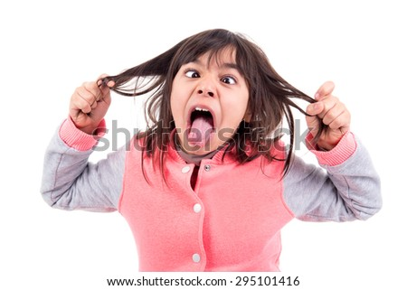 Funny young girl making faces isolated in white - stock photo