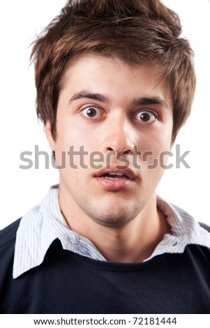 Funny young man being amazed and surprised - stock photo