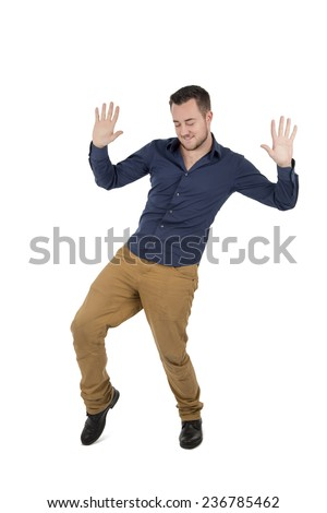 Funny young man dancing against a white background - stock photo