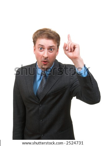 Funny young man in business suit pointing his finger up and saying something isolated on white - stock photo