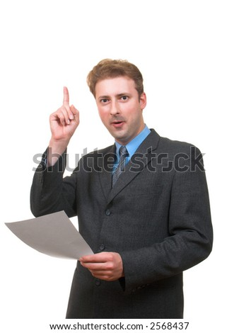 Funny young man in business suit with papers in his hand pointing his finger up as if he had an idea isolated on white - stock photo