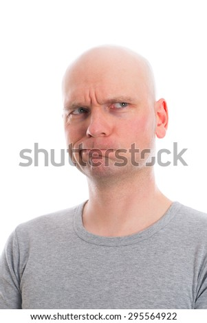 funny young man with bald head  is refecting