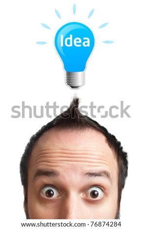 Funny young man with light  bulb over his head, isolated on white background - stock photo