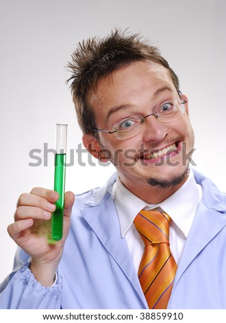 Funny young scientist holding an experimental tube. A doctor holding a glass tube. - stock photo