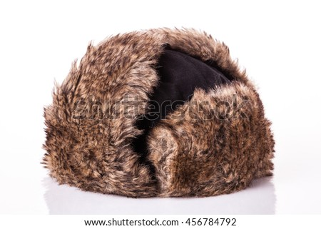 Fur cap for winter weather. Fur cap for winter isolated on white background - stock photo