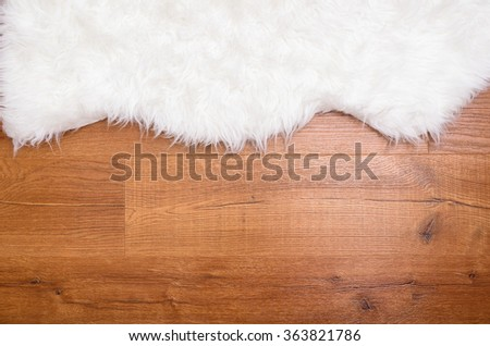 fur carpet on the wooden pvc floor - stock photo