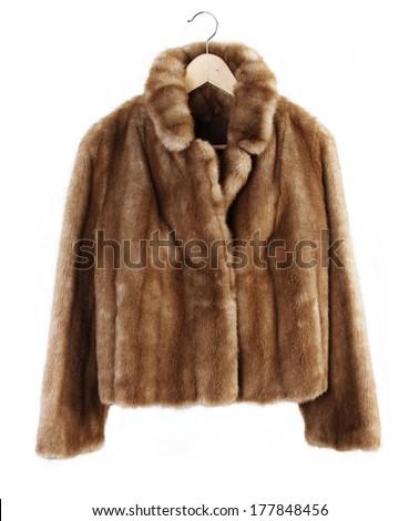 Fur coat on hanger isolated on plain background - stock photo