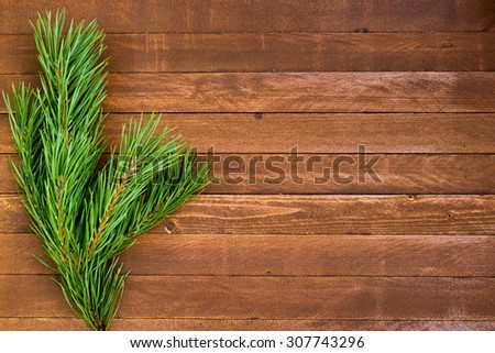 Fur-tree branch on wooden background, copy space - stock photo