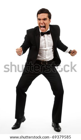furious adult yelling and holding his fists ready to fight, sanding and wearing formal clothes