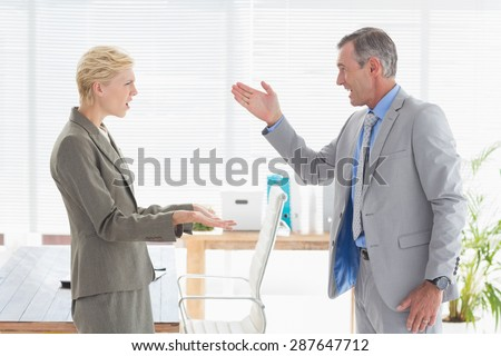 Furious boss yelling at colleague in an office - stock photo