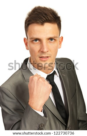Furious business man showing his fist isolated on white background