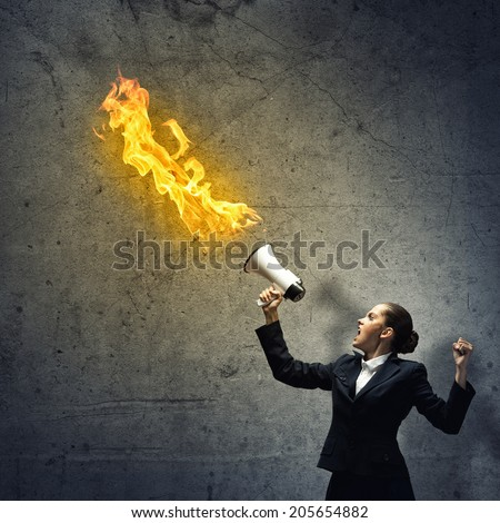 furious business woman with a megaphone shouting megaphone lifted up - stock photo
