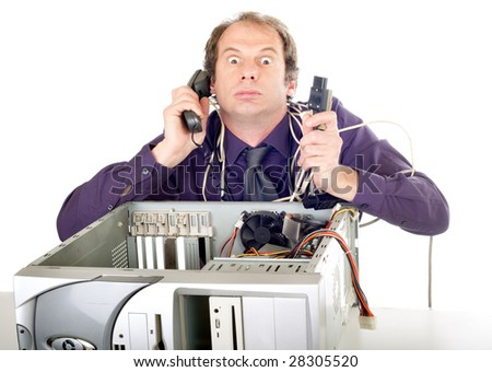 furious businessman having computer problems trying to call hotline - stock photo