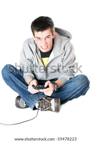 Furious guy with a joystick for game console. Isolated - stock photo