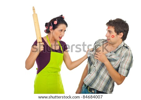 Furious housewife beat her unfaithful husband with a pin rolling  isolated on white background - stock photo