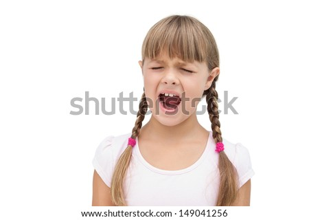 Furious little girl with eyes closed on white background - stock photo