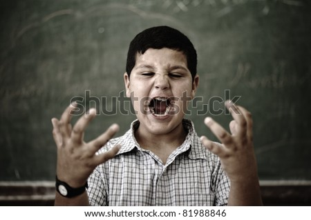 Furious mad pupil at school yelling - stock photo