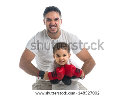 Furious son and father with boxing gloves - stock photo