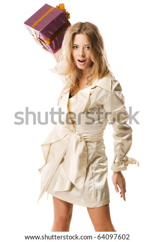 Furious woman throwing a gift box, white background - stock photo