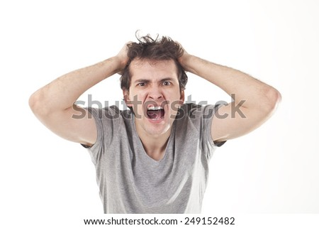 Furious Young Man. - stock photo