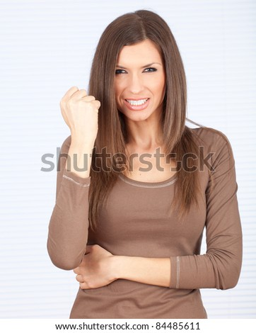 furious young woman with raised hand - stock photo