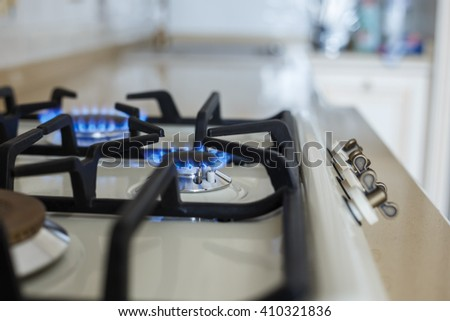 furniture background. Gas plate on a stone surface in the kitchen. small depth of field - stock photo