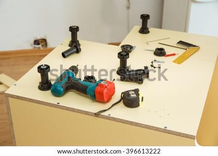 Furniture manufacturing inside kitchen legs - stock photo