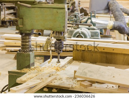 Furniture production plant, factory with industrial drilling and milling mechanical machinery - stock photo