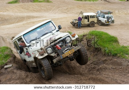 FURSTENAU, GERMANY - MAY 09, 2015: A Toyota 4-wheel drive is driving on a special off the road terrain for land cruisers and vehicles in Germany - stock photo