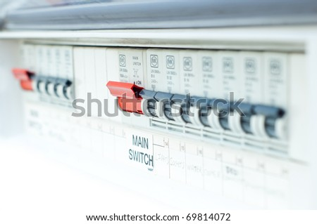 fusebox, with red button in focus - stock photo