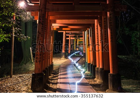 Fushimi Inari Taisha Shrine at night, Kyoto, Japan. - stock photo