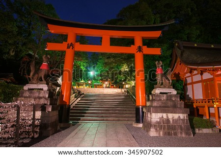 Fushimi Inari Taisha Shrine at twilight. Here  is head shrine of Inari including trails up the mountain to many smaller shrines for 4 kilometers in Kyoto, Japan. - stock photo