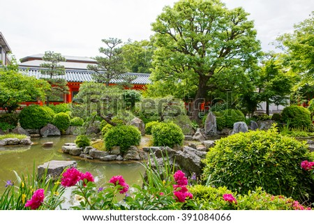 Fushimi Inari Taisha Shrine in Kyoto, Japan with beautiful red gate and japanese garden - stock photo