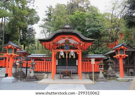 Fushimi Inari Taisha Shrine is the head shrine of Inari including trails up the mountain to many smaller shrines which span 4 kilometers in Kyoto, Japan. - stock photo