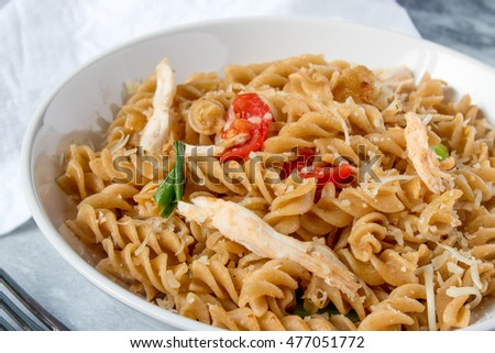 Fusili pasta with tomato sliced and chicken