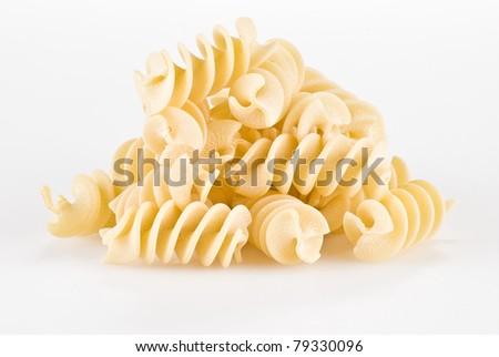 Fusilli pasta isolated over white background - stock photo