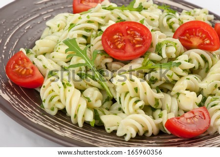 Fusilli pasta with tomato and arugula