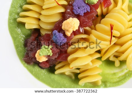 fusilli with sea bass and broccoli - stock photo