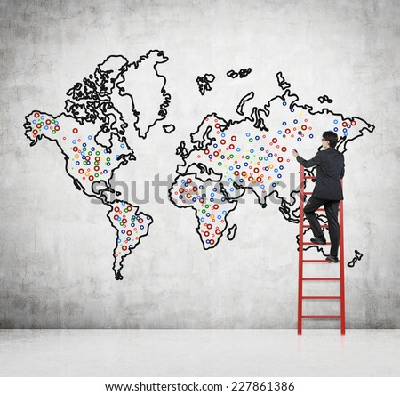 Future business developments strategy. Businessman drawing the world map and the main points to expand the business.  - stock photo